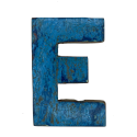 Wooden letter E made out of old fishing boats