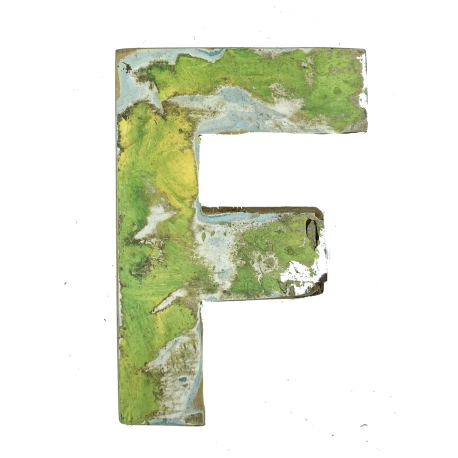 Wooden letter F made out of old fishing boats