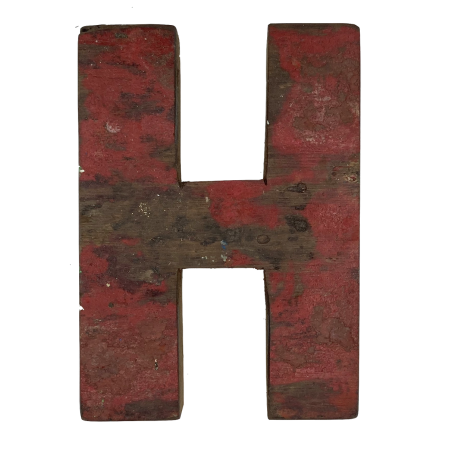 Wooden letter H made out of old fishing boats
