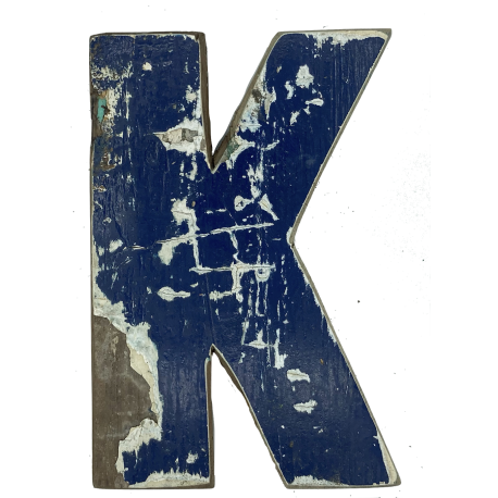 Wooden letter K made out of old fishing boats