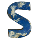 Wooden letter S made out of old fishing boats