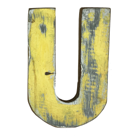 Wooden letter U made out of old fishing boats